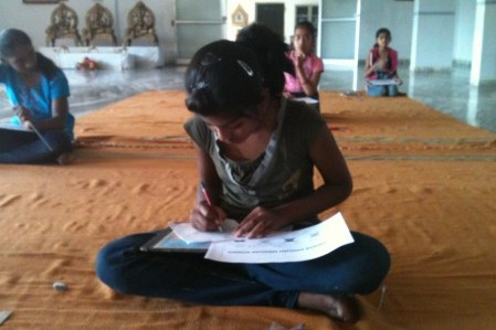Mukti Girl Writing Close Up